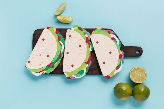 Flat lay paper tacos on wooden board