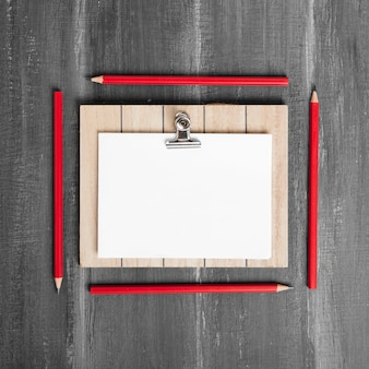Flat lay of papers and clipboard on wooden table