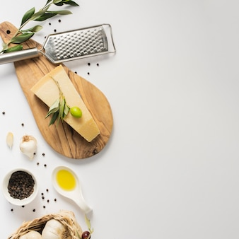 Flat lay parmesan on cutting board with copy space
