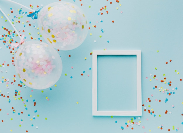 Flat lay party decoration with balloons and frame