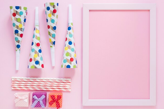 Flat lay party items on pink background