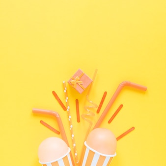 Flat lay party items on yellow background