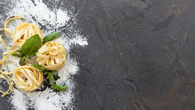Flat lay of pasta arrangement with copy space