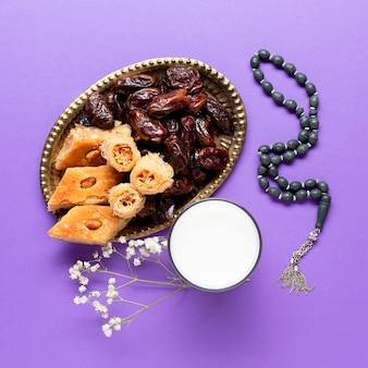 Flat lay of pastries and dates