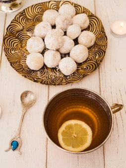 Flat lay pastries and lemon tea