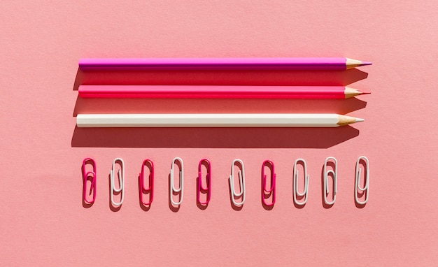 Flat lay pencils and paper clips