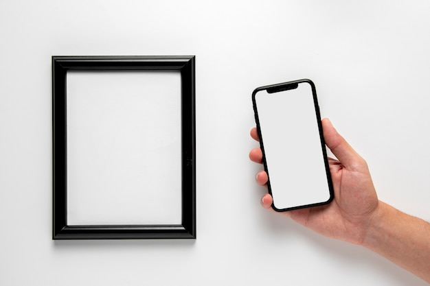 Flat lay phone next to frame mock-up