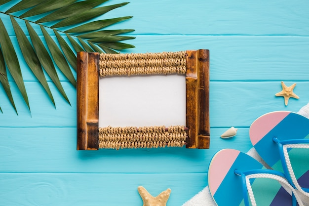 Flat lay photo frame with palm leaf