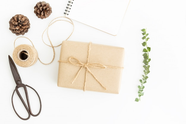 Flat lay photo of gift wrap and old scissors on white background