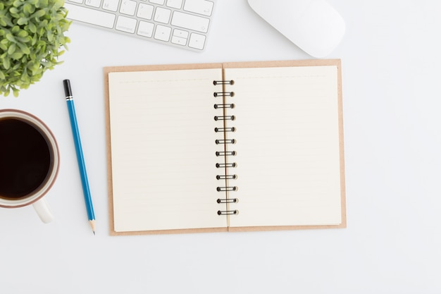 Flat lay photo office desk with mouse and pencil on notebook