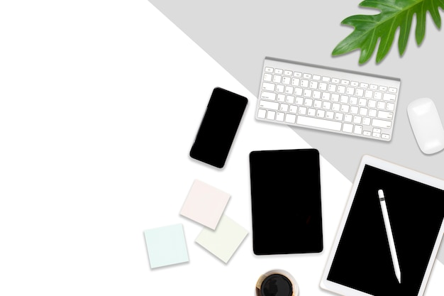 Flat lay photo of office table with laptop computer, digital tablet, mobile phone and acce