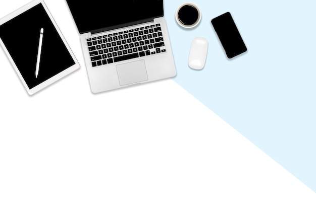 Flat lay photo of office table with laptop computer, digital tablet, mobile phone and accessories.