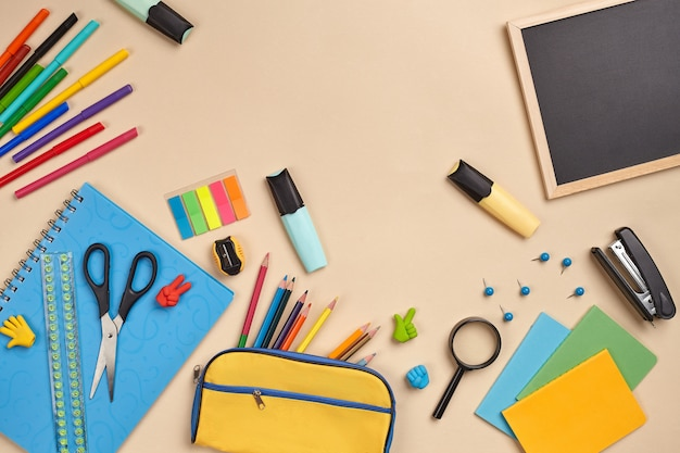 Flat lay photo of workspace desk with school accessories