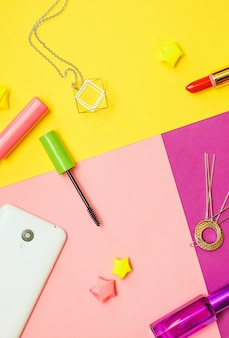 Flat lay photography with cosmetics and accessories on colorful background
