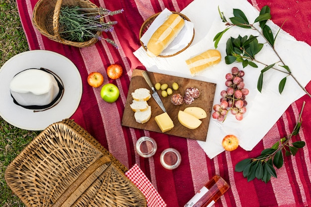 Flat lay picnic arrangement on red blanket