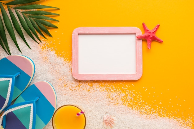 Flat lay picture frame with beach concept