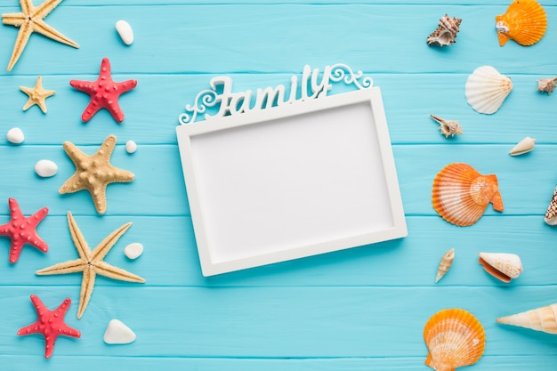Flat lay picture frame with starfish and seashells