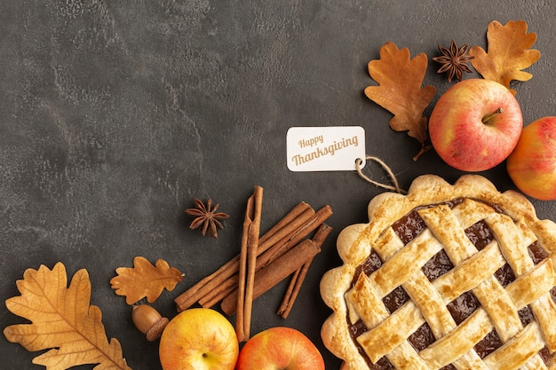 Flat lay pie and apples on stucco background
