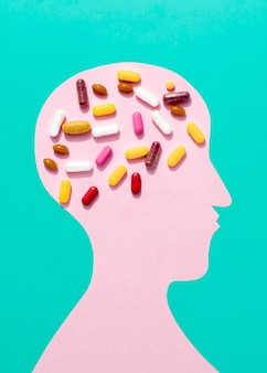 Flat lay of pills on brain of human shape