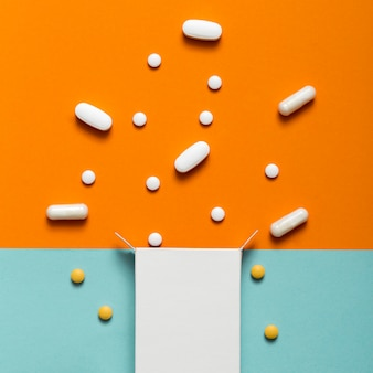 Flat lay of pills coming out of box