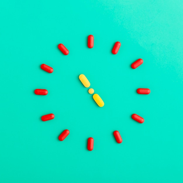 Flat lay of pills forming a clock