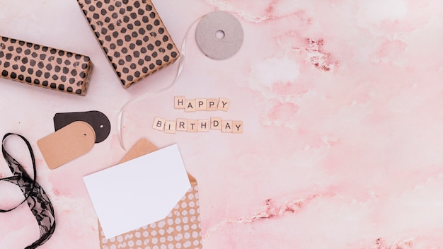 Flat lay pink birthday supplies with copy space