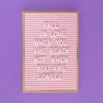 Flat lay pink board with message