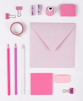 Flat lay pink items arrangement