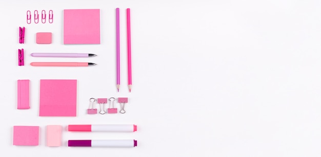 Flat lay pink items with copy-space