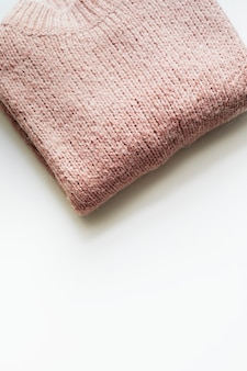 Flat lay of pink knitted sweater