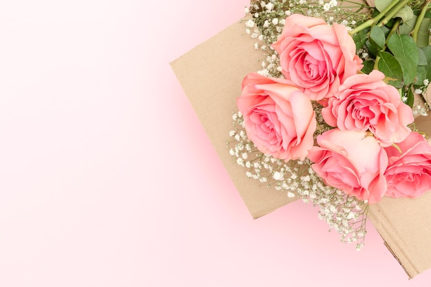 Flat lay of pink roses bouquet