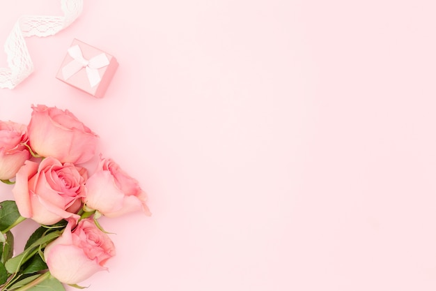 Flat lay of pink roses with copy space