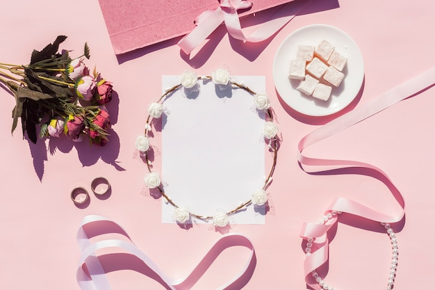 Flat lay pink wedding arrangement with on background