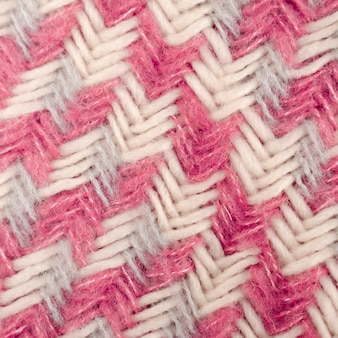 Flat lay of pink and white wool pattern