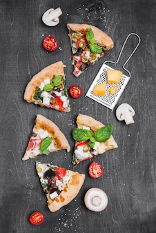 Flat lay pizza slices composition