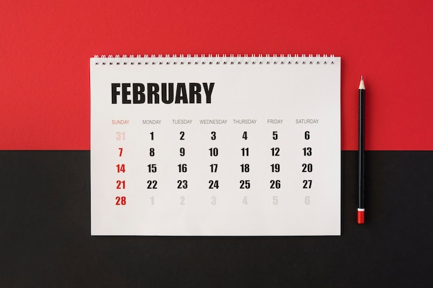 Flat lay planner calendar on red and black background