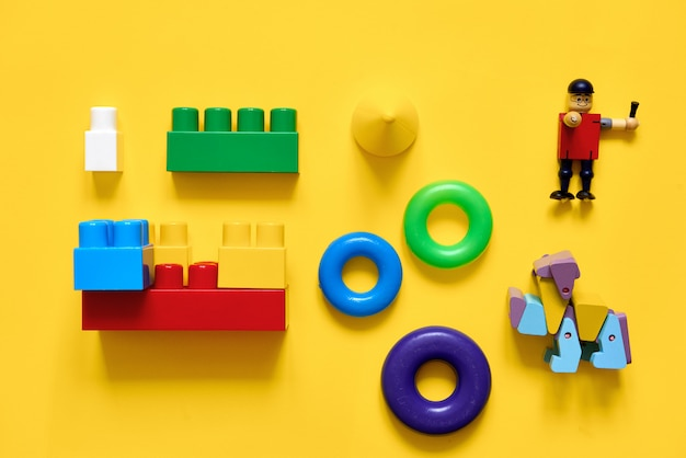 Flat lay of plastic and eco wooden toys.