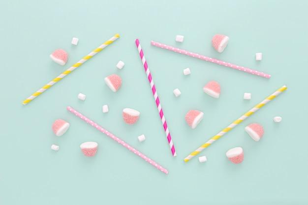 Flat lay plastic straws and jellies