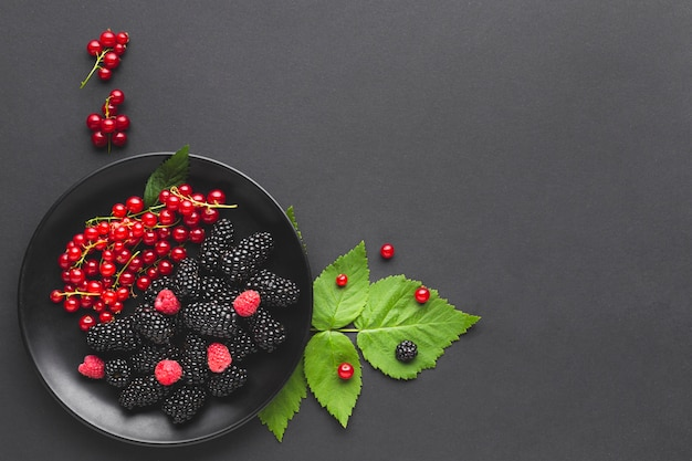 Flat-lay plate of berries with copyspace