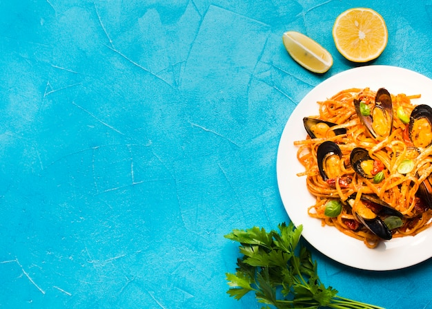Flat-lay plate of mussels pasta with copyspace