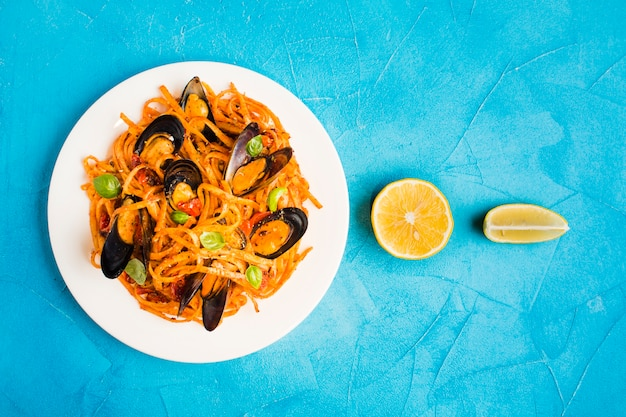 Flat-lay plate of pasta with mussels