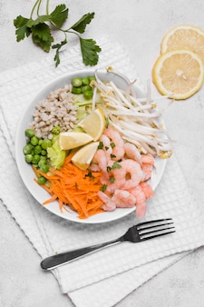 Flat lay of plate of shrimp and vegetables