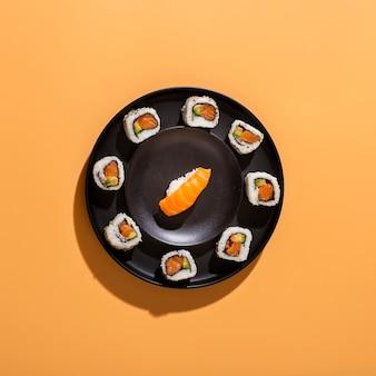 Flat lay plate of sushi rolls with nigiri