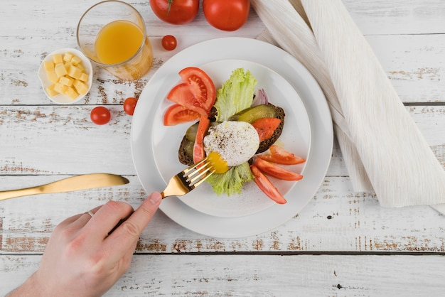 Flat lay plate with breakfast on table