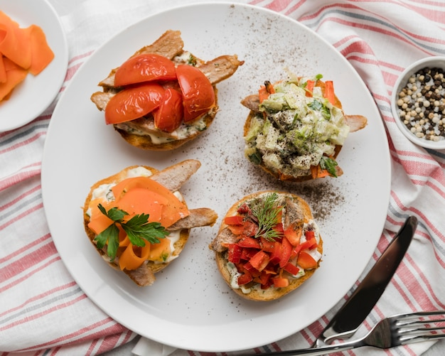 Flat lay plate with bruschettas