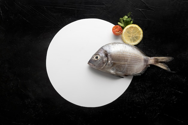 Flat lay of plate with fish and lemon