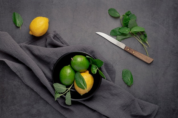 Flat lay of plate with limes and lemons