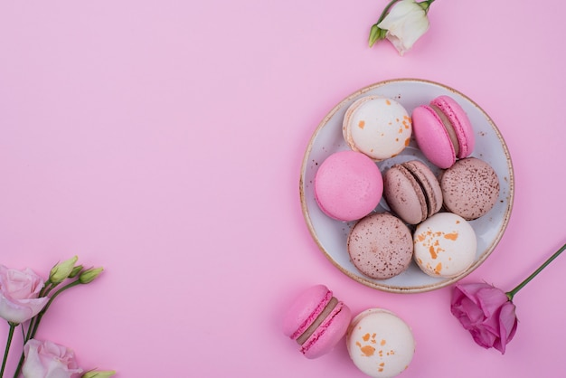 Flat lay of plate with macarons and copy space