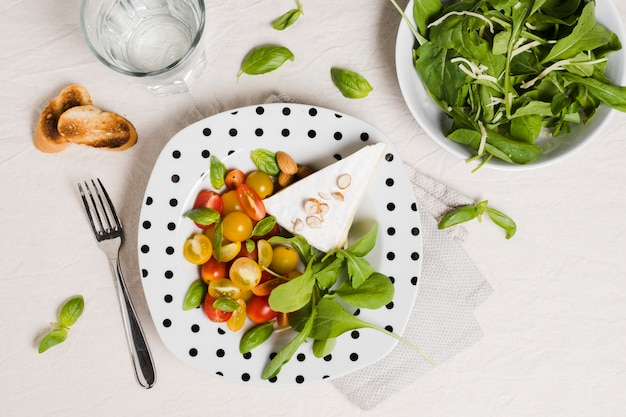 Flat lay of plate with organic vegetables and salad
