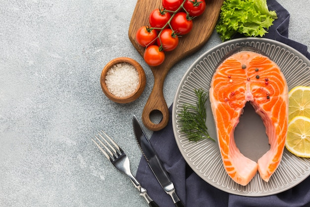 Flat lay plate with salmon and lemon